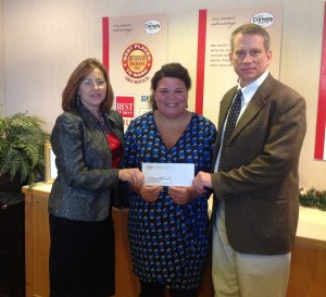 Conway Director of Relocation (left) and CFO Bryan Keaney present Shannah Paddock of the Alzheimer's Association a check from the company's participation in the South Shore Walk to End Alzheimer's.